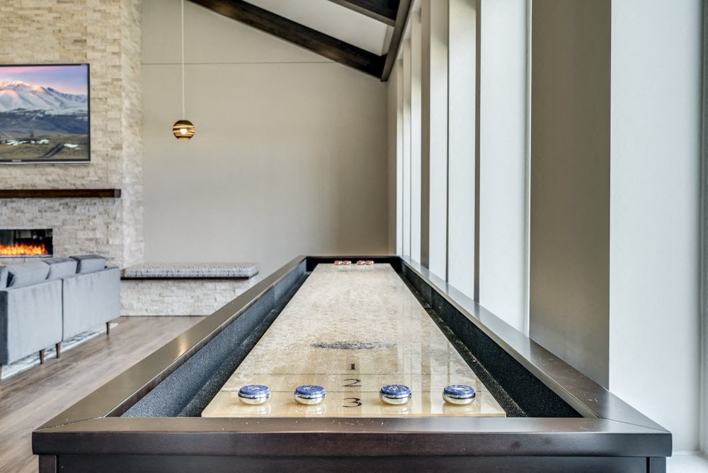Shuffleboard table in the clubhouse at Ascend at Woodbury apartments in MN