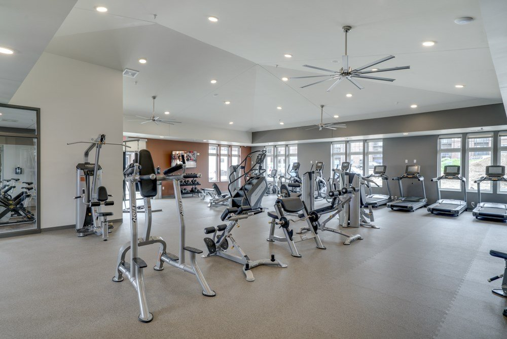 Large fitness center with free weights, weightlifting machines and cardio equipment at Ascend at Woodbury MN 55129 new luxury apartments