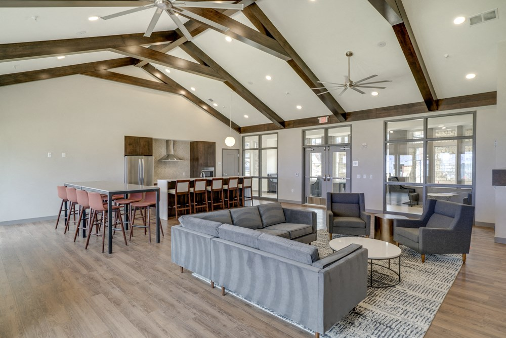 Clubhouse with seating and deluxe kitchen for entertaining at Ascend at Woodbury new luxury apartments in Woodbury MN 55129