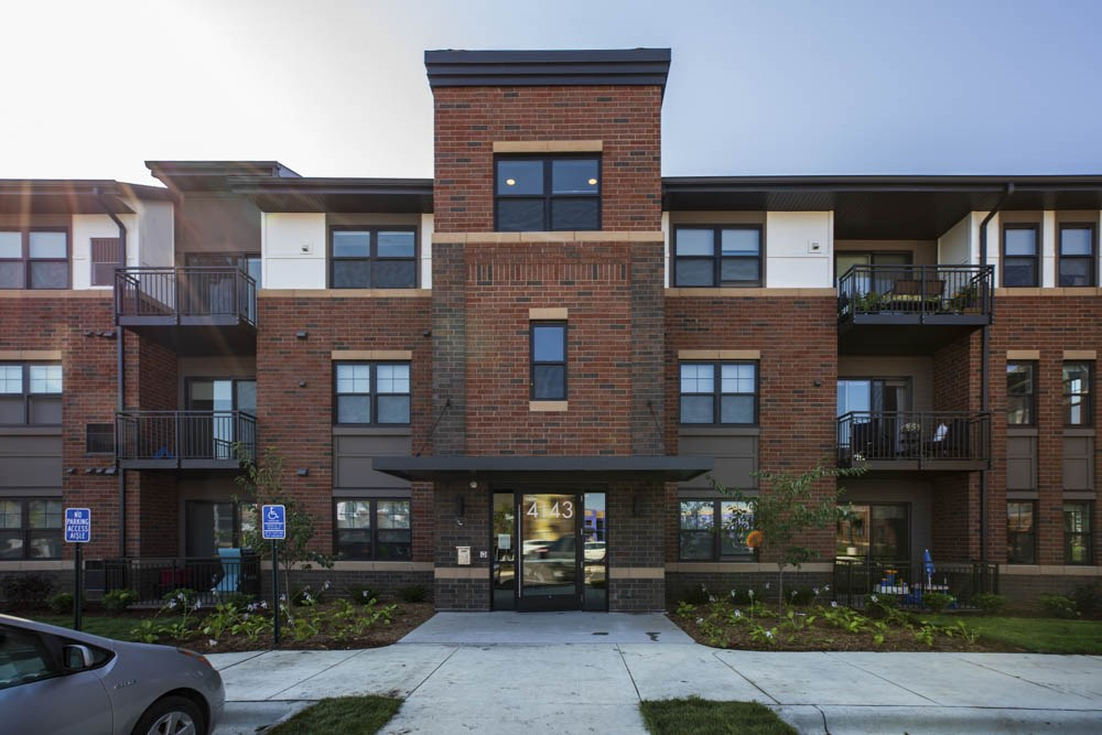 Exterior building view with controlled access entry at Ascend at Woodbury MN 55129 new luxury apartments