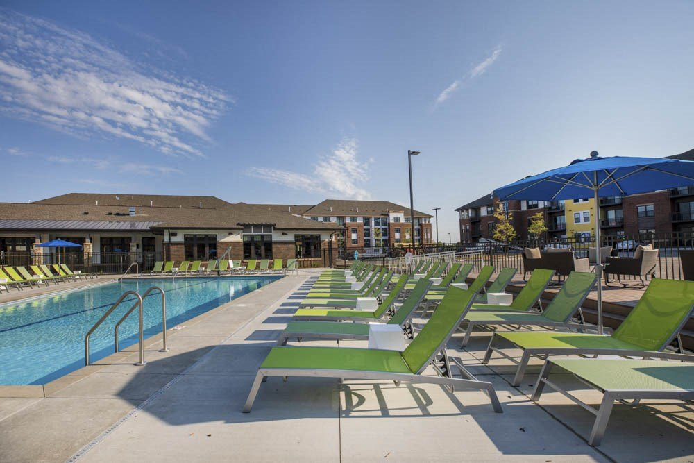 Lounge chairs next to resort-style pool at Ascend at Woodbury new luxury apartments in Woodbury MN 55129