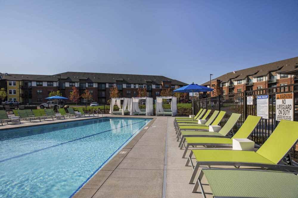 Outdoor swimming pool with cabanas and lounge chairs at Ascend at Woodbury MN 55129 new luxury apartments
