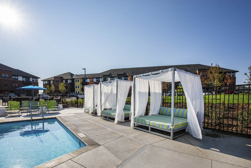 Pool with resort-style cabana seating at Ascend at Woodbury new luxury apartments in Woodbury MN 55129