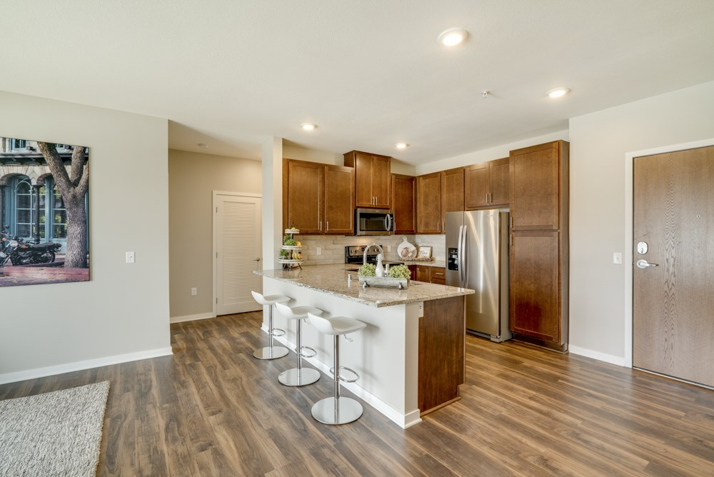 Open floor plan with kitchen at Ascend at Woodbury apartments in MN