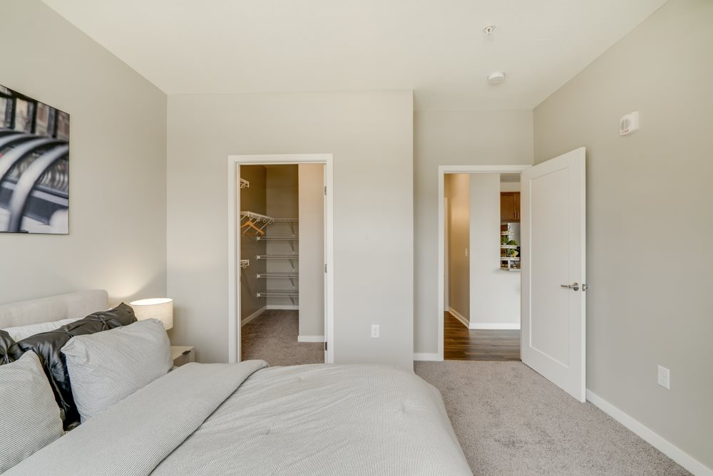 Bedroom with walk-in closet at Ascend at Woodbury in Woodbury MN