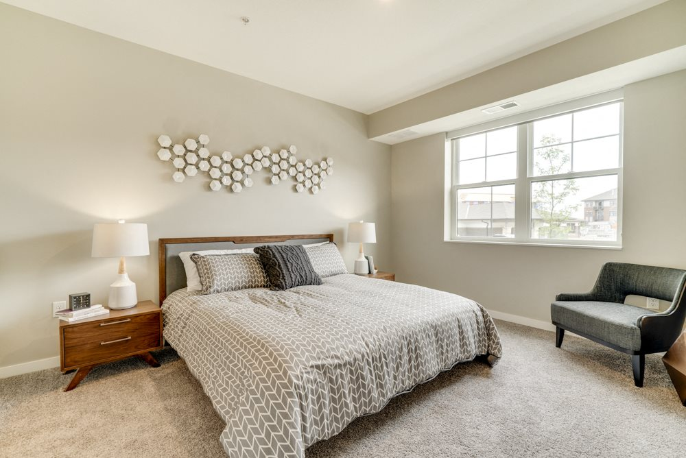 One bedroom apartment bedroom with large windows at Ascend at Woodbury MN 55129 new luxury apartments