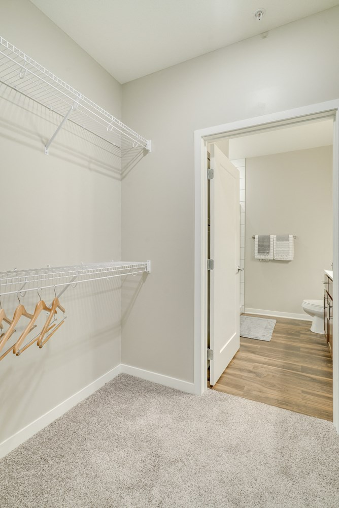 Large walk-in closet at Ascend at Woodbury apartments in MN.