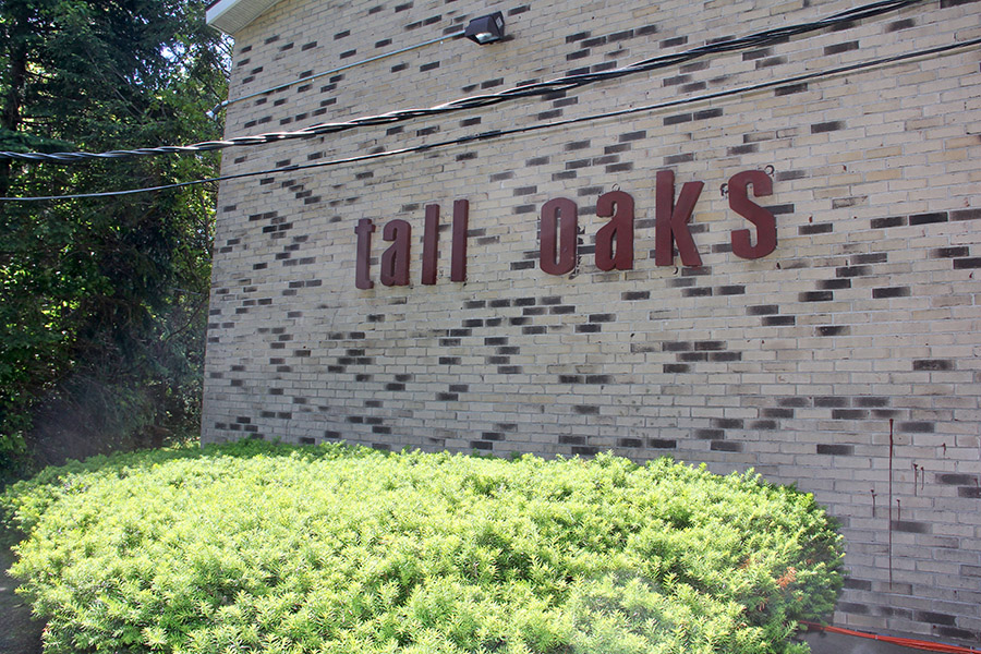 Tall Oaks Sign on Building