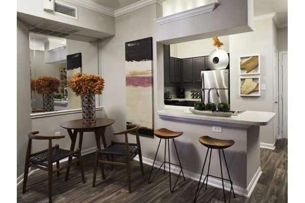 Gourmet Kitchen with Breakfast Bar and Pantry at Neo Midtown, 14151 Noel Rd, Dallas, TX
