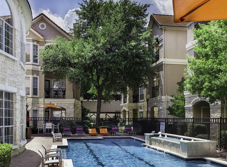 Lounge poolside at Neo at Midtown Apartments in Dallas, TX