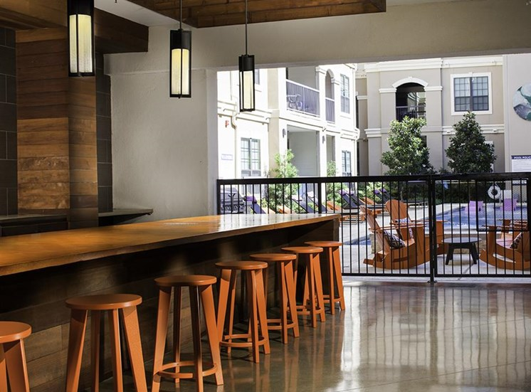 Outdoor poolside kitchen at Neo Midtown Apartments in Dallas, TX