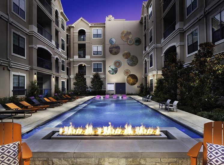 Twilight pool at Neo Midtown Apartments in Dallas, TX