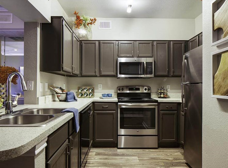 Sleek and modern kitchens at Neo Midtown Apartments in Dallas, TX