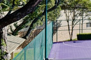 Fun basketball and tennis court at Juniper Springs, Northwest Austin