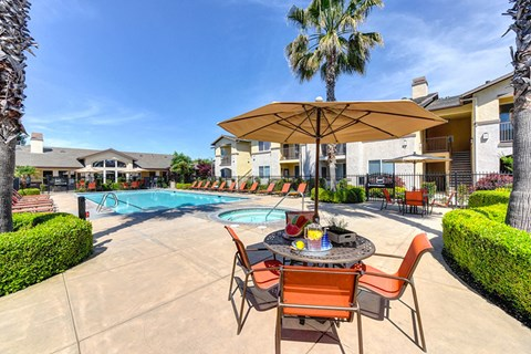 Pool and lounge chairs l Eaton Village Apartments in Chico CA