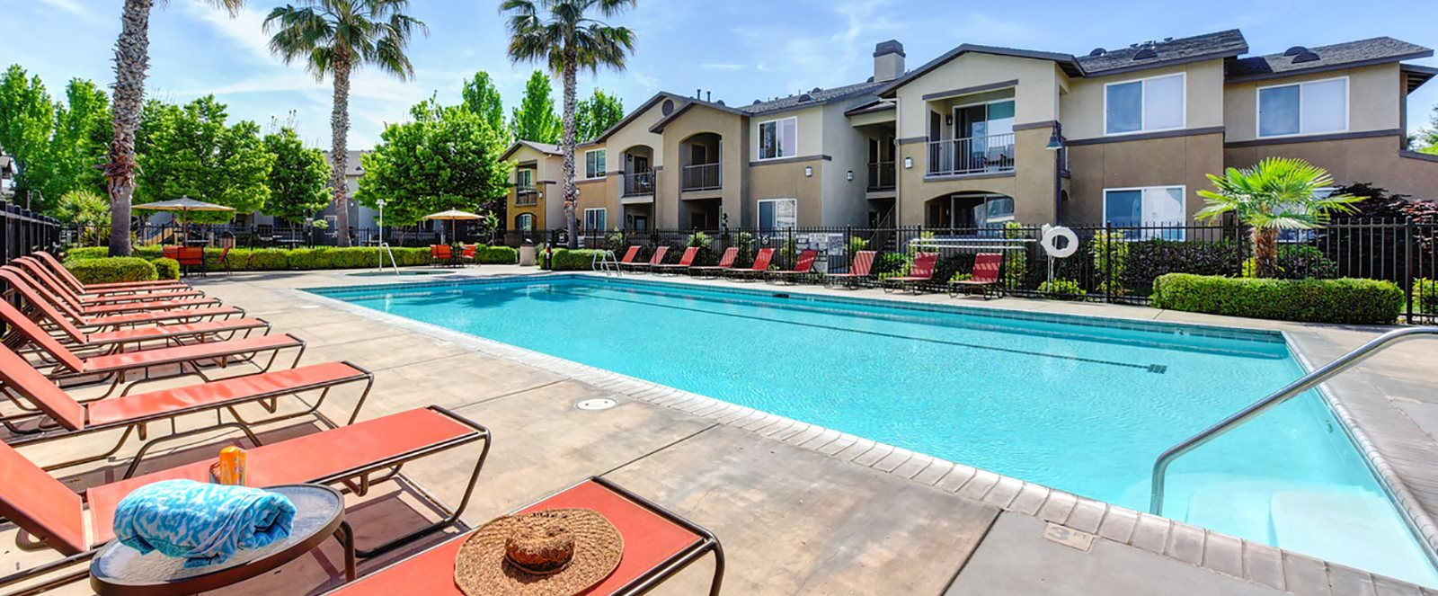 Pool with lounge chairs l Eaton Village Apartments in Chico CA