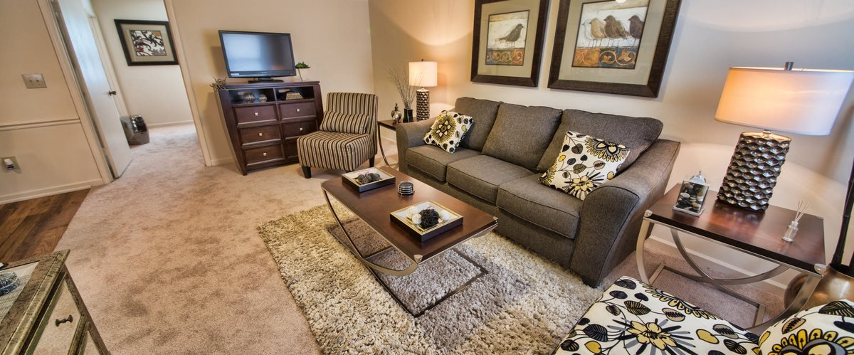 Executive Lodge Apartments Living Room in Huntsville, AL