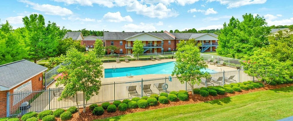 Open Green Space and Resort-Style Pool at Regal Pointe Apartments in Tuscaloosa, AL