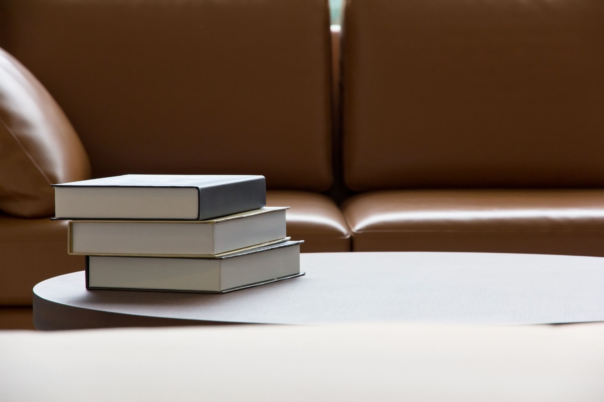 stock image of books on coffee table
