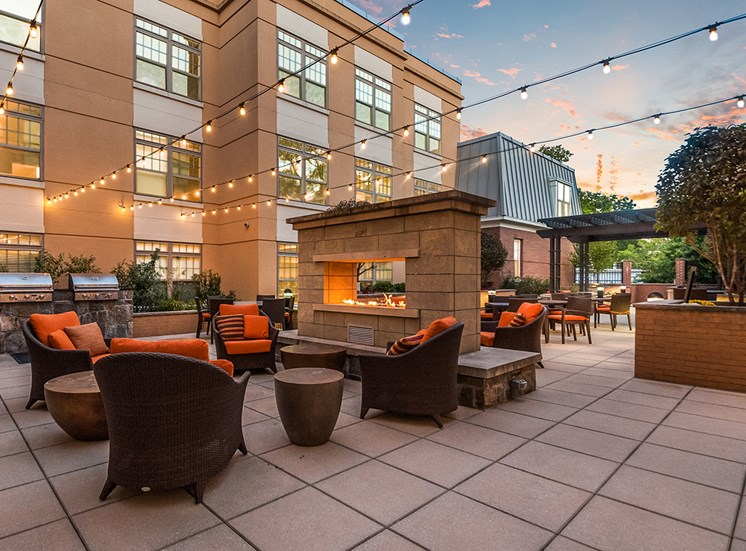 Charming courtyard with fireplace and BBQ grills at Northgate Apartments in Virginia