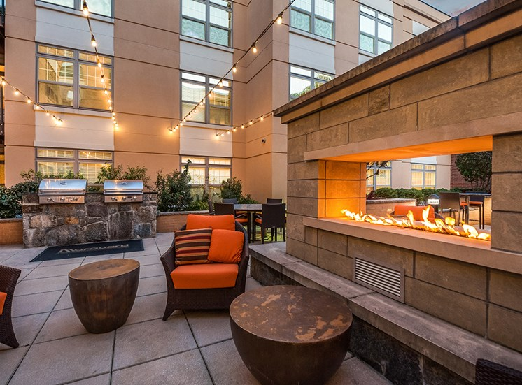 Sit next to the fireplace in Northgate's private courtyard in Virginia