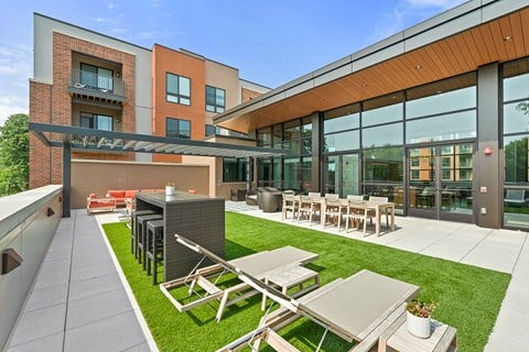 Exton apartment roof-top lounge with fire pits at Keva Flats