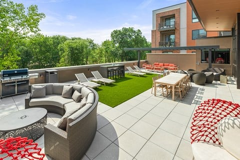 Roof-top terrace with grill, fire pits, and lounge area at Exton apartments Keva Flats