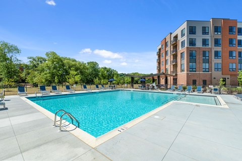 resort-style swimming pool with sun deck, grills, lounges, fire pits & games in Exton PA apartment building.