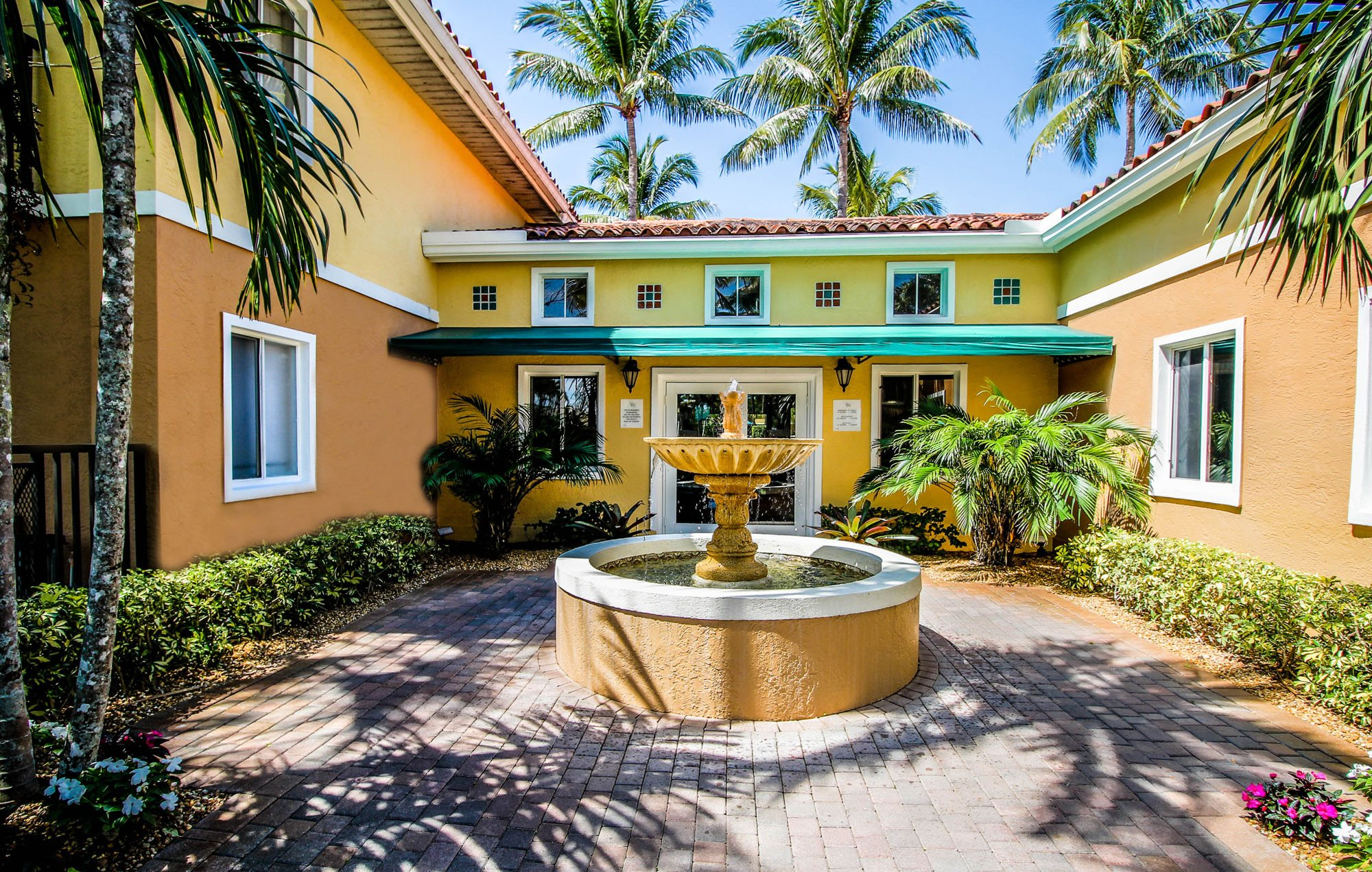 Beautiful Courtyard Fountain at Coconut Palm Club Apartments, 5400 NW 55th Blvd. FL