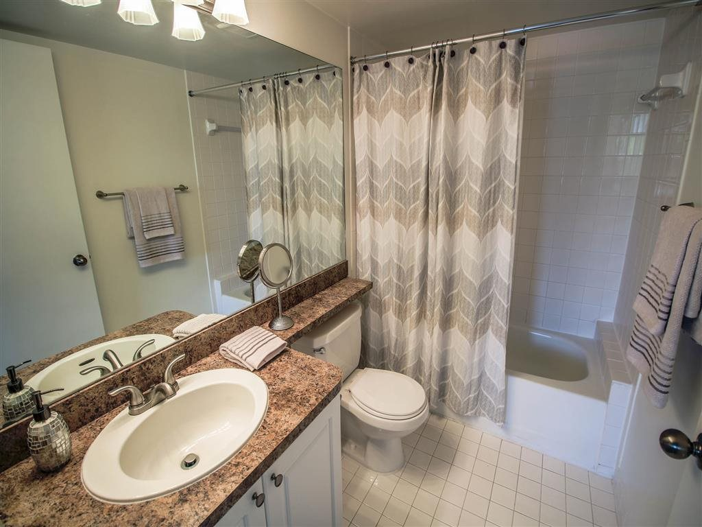 Designer Granite Countertops in all Bathrooms at Coconut Palm Club Apartments, 5400 NW 55th Blvd., FL 33073