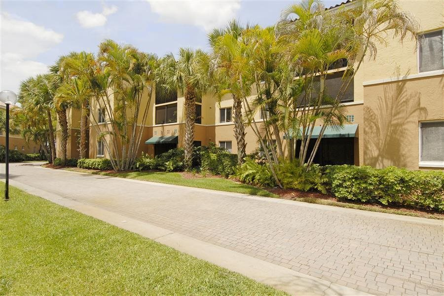 Beautifully-Landscaped Grounds With Walking Trails at Coconut Palm Club Apartments, 5400 NW 55th Blvd. FL