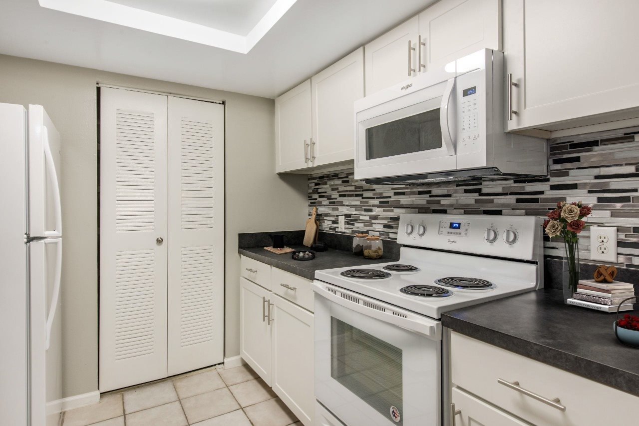 Fully Equipped Kitchen with White Appliances
