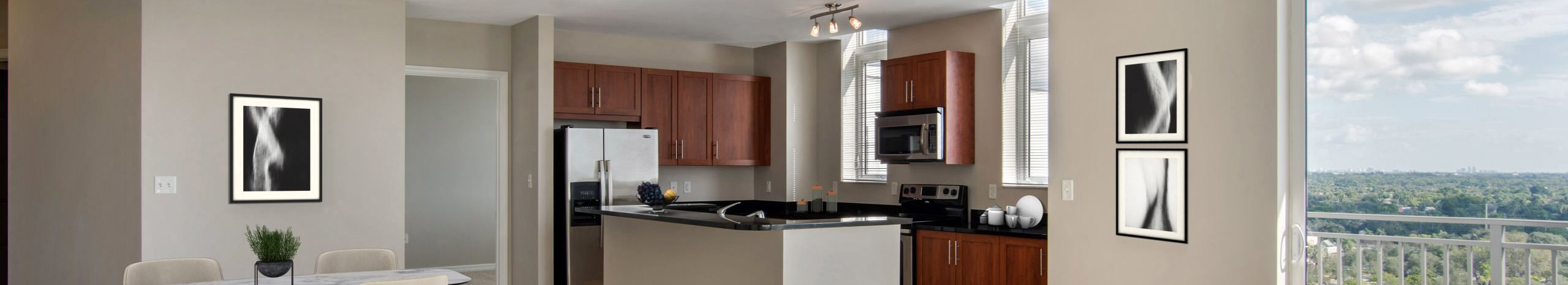 Midtown 24 Apartments virtual model, living room and kitchen with patio view