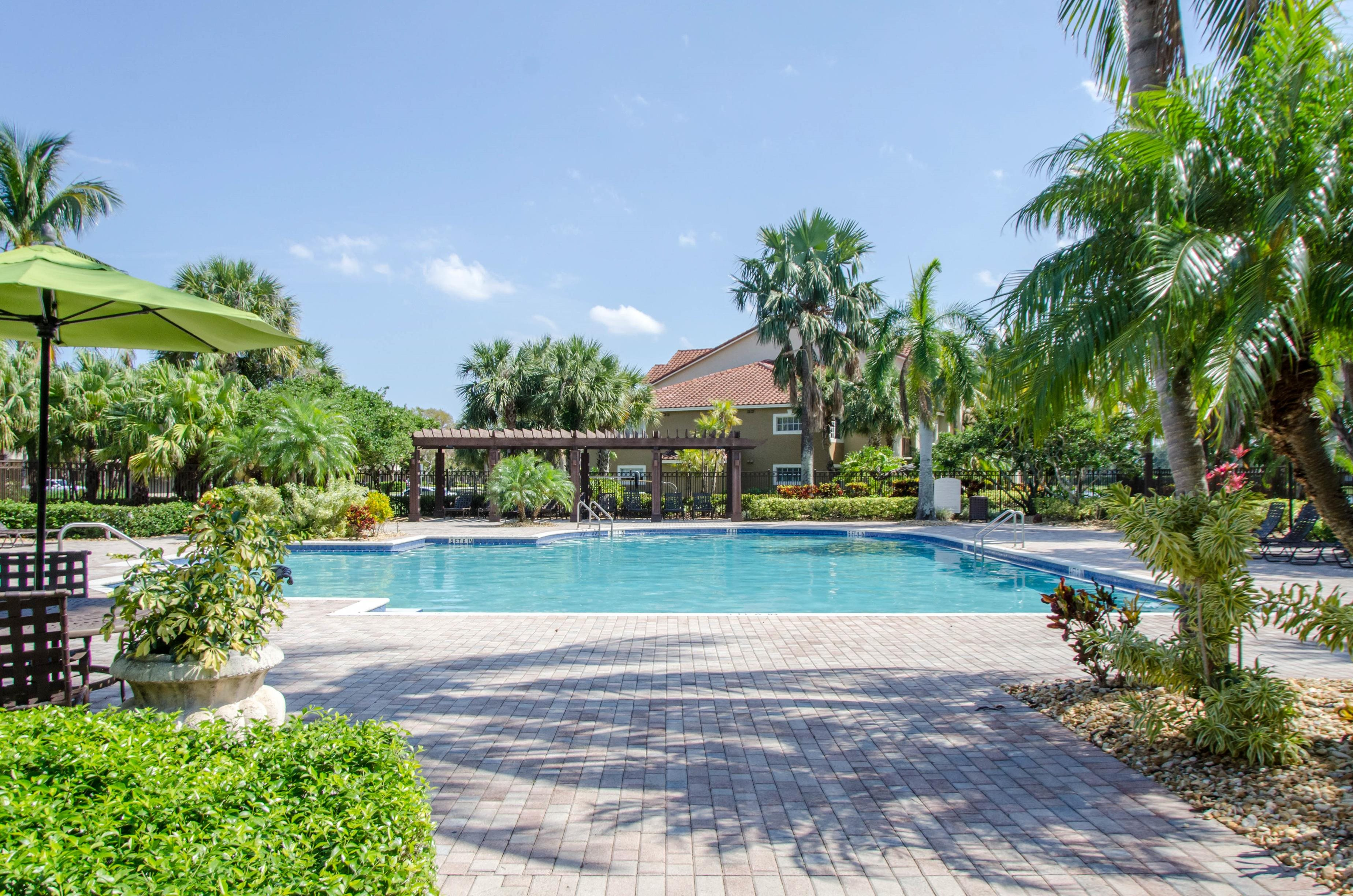 Seasonal Beautiful Outdoor Swimming Pool at Oasis Delray Apartments, 5600 W. Atlantic Ave., Delray Beach, FL