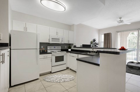 The Preserve at Deer Creek | Fully Equipped Kitchen with White Appliances and Tile Flooring