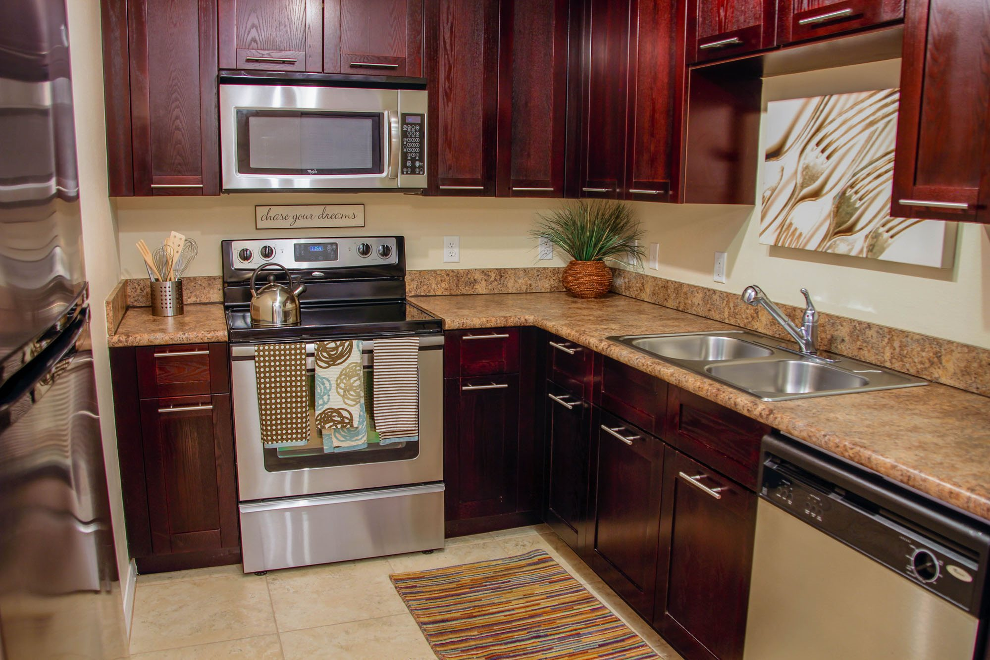 Red Road Commons Student Living Kitchen with Granite and Stainless Appliances