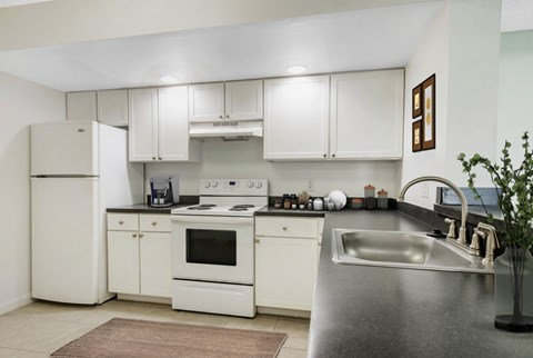 Kitchen with White Appliances and Tile Flooring