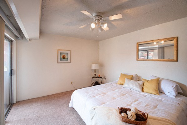 Bedrooms With Lighted Ceiling Fan at Desert Creek, Albuquerque, New Mexico
