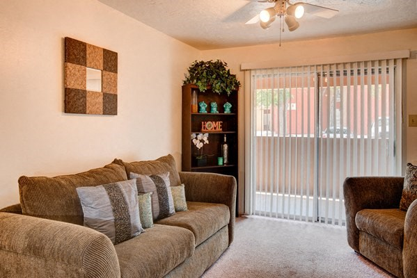 Living Rooms With Decorative Blinds at Desert Creek, Albuquerque, NM 87107