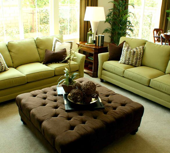 Model living room with 2 comfy couches