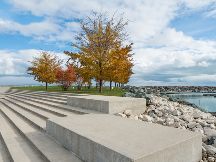 Image of concrete steps, with tree and Lake Michigan in the background