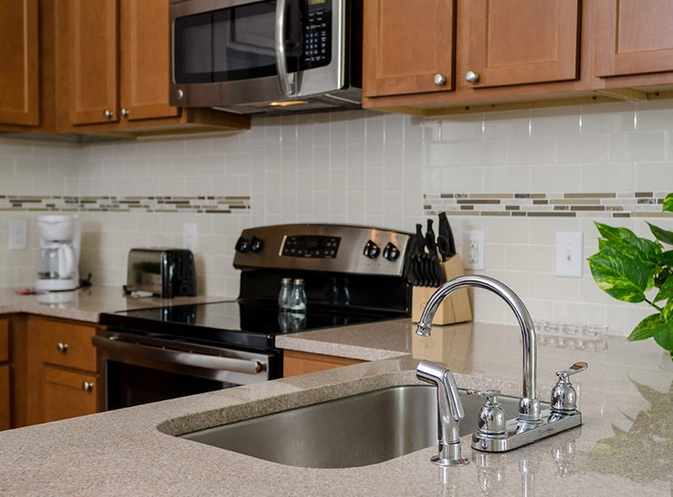 Kitchen sink and stove at City Block Apartments