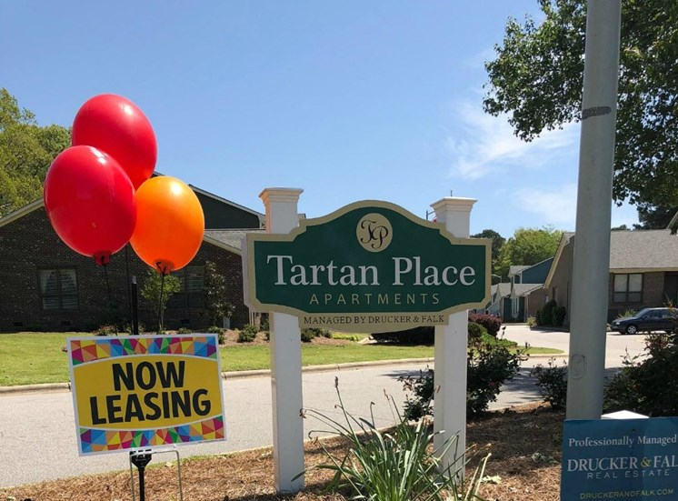 Now Leasing and Tartan Place Sign