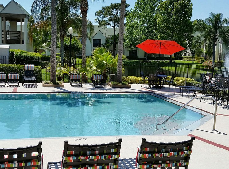 Pool and chairs at Cypress Run Apartments