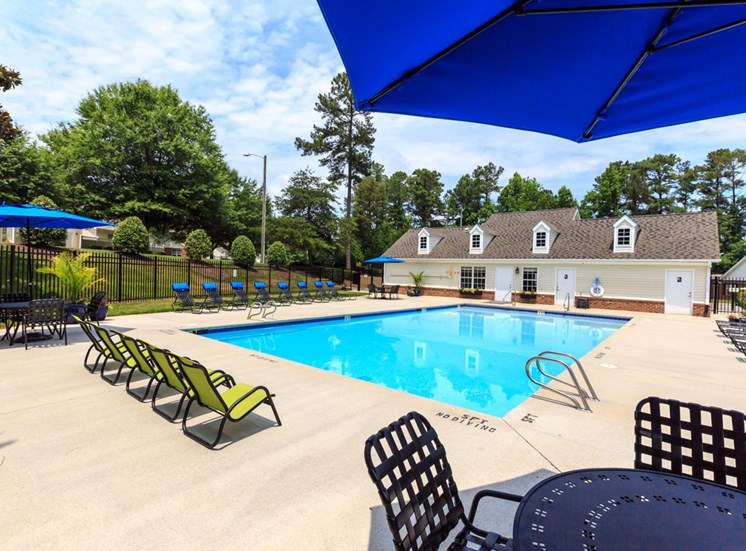 Pool with chairs at Fairgate Apartments in Raleigh NC