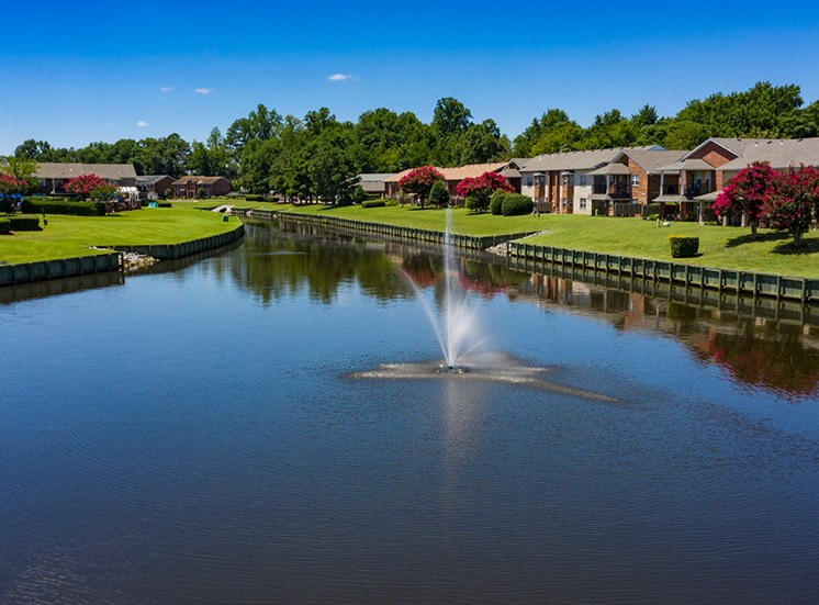Canal and fountain at Holly Point Apartments