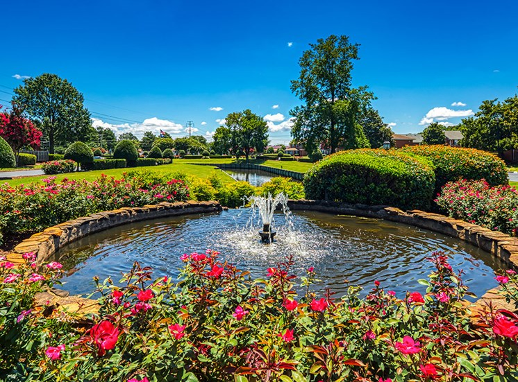 flowers and fountain at Holly Point Apartments in Chesapeake VA