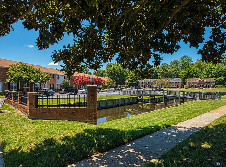path, fence and canal at Holly Point Apartments