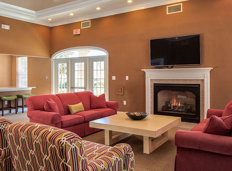 Clubhouse chairs and fireplace at Magnolia Chase Apartments