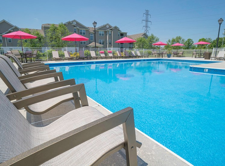 Chairs and pool at Magnolia Chase Apartments